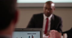 Caucasian and African American business colleagues in a boardroom meeting. - stock footage