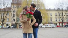 Woman meeting with her boyfriend on public square - stock footage