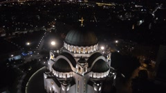 Night aerial view of biggest orthodox church in Serbia. - stock footage