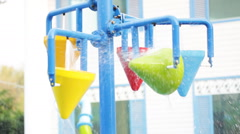 Colorful bucket splash in aqua park Stock Footage