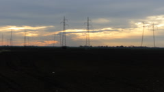 Sunset Agriculture with Electric poles in soil field Stock Footage