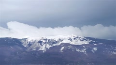 Clouds and shadows moving on snowy mountain-timelapse Stock Footage