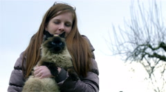 Woman holding cat while it bites her hand 4K Stock Footage