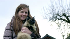 Woman and cute cat portrait outside in nature 4K Stock Footage
