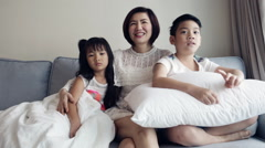 Young Asian family playing and Watching TV . - stock footage