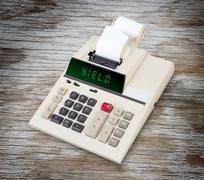 Old calculator - yield - stock photo
