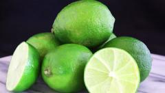 Limes and half lime rotating Stock Footage