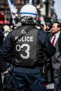 Detail of the Back of a Police Facing protesters. - stock photo