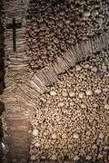 The wall made of human bones and skulls - stock photo