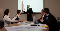 A young male African American team leader presenting a financial report. Slow mo Stock Footage