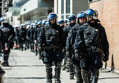 Cops Following Marchers in case of something Goes Wrong - stock photo
