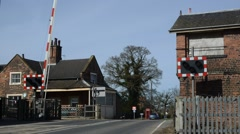 Time lapse of railway level crossing united kingdom Stock Footage