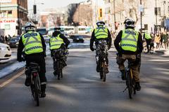 Four Cops using Bike for Fast and easy Moving. - stock photo