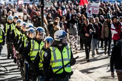 Cops Following the Marchers to make sure everything is under Control - stock photo
