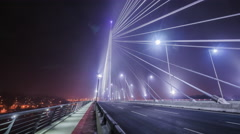 Belgrade  with traffic on Ada Bridge at night in time lapse Stock Footage