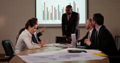 A confident businessman presenting a financial report to his team in slow motion Stock Footage