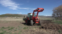 April plowing farm field large tractor turns around 4K 022 Stock Footage