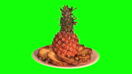 Stock Video Footage of Pineapple and segments on plate