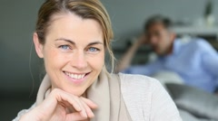 Portrait of mature woman with beautiful blue eyes - stock footage