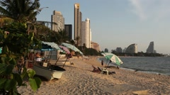 Beach bar with umbrellas. Beautiful bay and high condo buildings Stock Footage