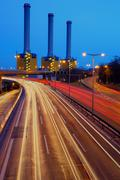 Power station behind a highway - stock photo