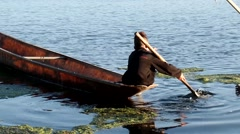 Little Boatman paddles row boat silhouettes Stock Footage