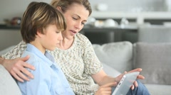 Mother with child websurfing on digital tablet Stock Footage
