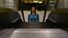 Woman Ascends Esclator Stock Footage
