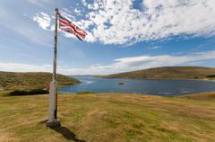 West Island in the Falklands with United Kingdom Union Flag Flying - stock photo