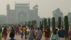 Tourism India, groups of tourists walk towards the Taj Mahal Stock Footage