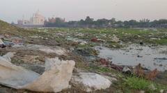 India Taj Mahal pollution garbage waste dirty river poverty dump Stock Footage