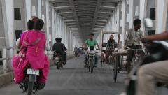 India, traffic drives over the Yamuna bridge in Agra Stock Footage