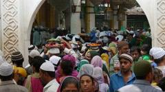 India, Dargah shrine, ritual ceremony, offering flowers, Islam, Muslims Stock Footage