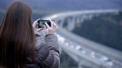 Person taking picture and zooming on traffic jam 4K Stock Footage