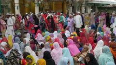 Islam in India, colorful scene, women reading verses during religious ceremony Stock Footage