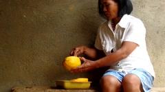 Peeling papaya Stock Footage