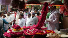 India, selling flowers nearby an Islamic shrine Stock Footage
