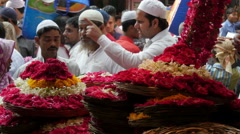 Islam in India, people sell flowers nearby religious shrine - stock footage
