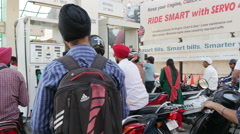 India economy, busy petrol station, motorbikes, waiting in line Arkistovideo