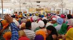 Amritsar, India, Golden Temple, pilgrims wait in line to visit the temple Stock Footage