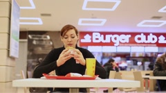 Woman in Fast Food Restaurant Stock Footage