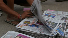 Sorting newspapers on the streets of Amritsar, India Stock Footage
