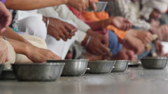 Amritsar, India, Golden Temple, communal kitchen, people eating food Stock Footage