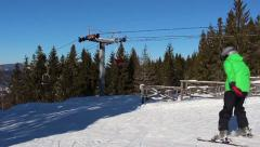 Ski lift and woman skiing near Stock Footage