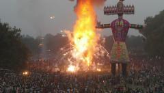 India Dussehra festival, huge crowds, firework display, exploding puppets Stock Footage