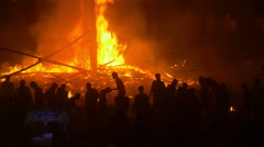 Crowds gather around massive fire during Hindu religious festival in India Stock Footage