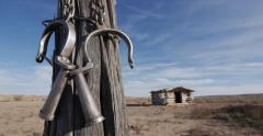 Wild West Ghost Town Outlaw Hideout Pan Down to Prisoner Chains - stock footage