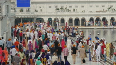 Pilgrims visit the Golden Temple complex in Amritsar, India Stock Footage