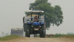 India agriculture, tractor, transportation, industrial, farming, village life Stock Footage