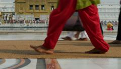 Pilgrims walk past the Golden Temple in Amritsar, India Stock Footage